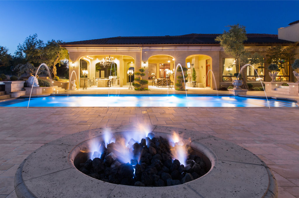 Backyard mansino with pool and firepit