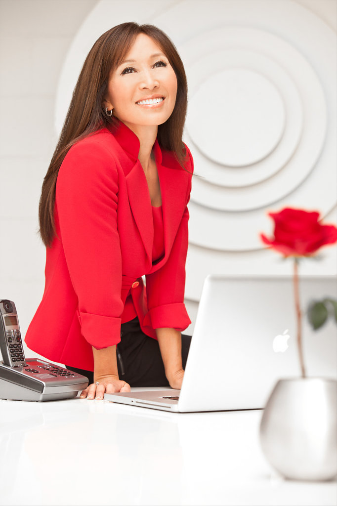 Business executive in red suit portrait