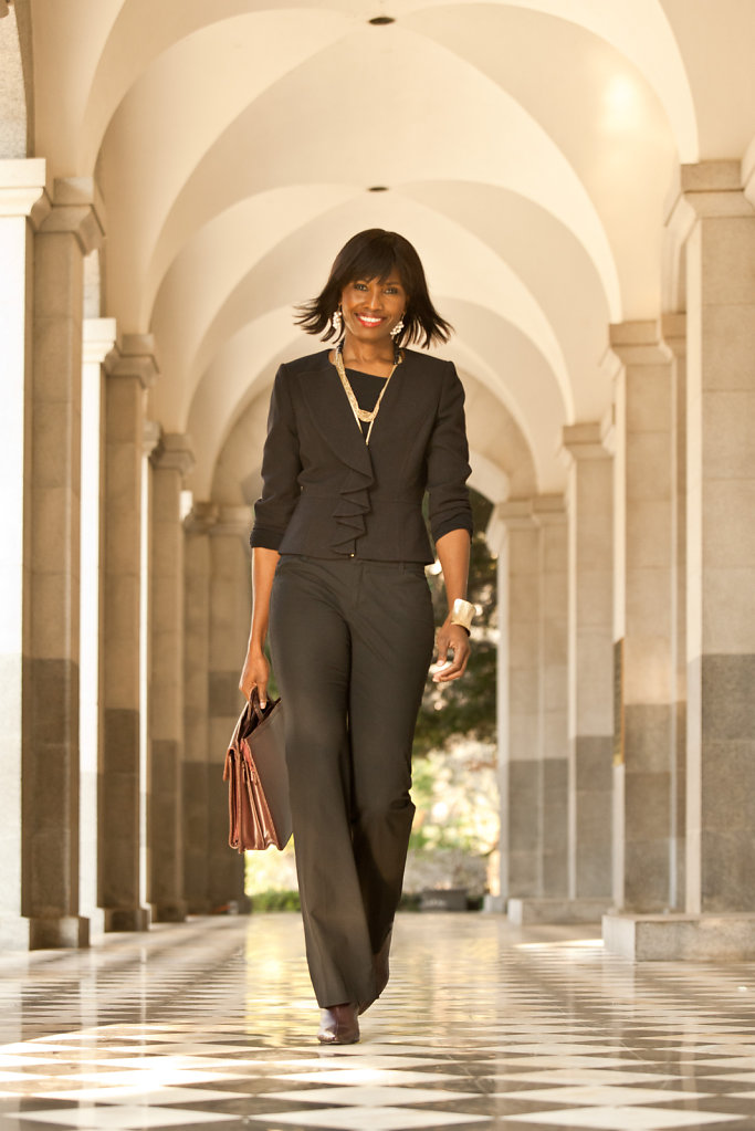 Business woman with briefcase at State Capitol