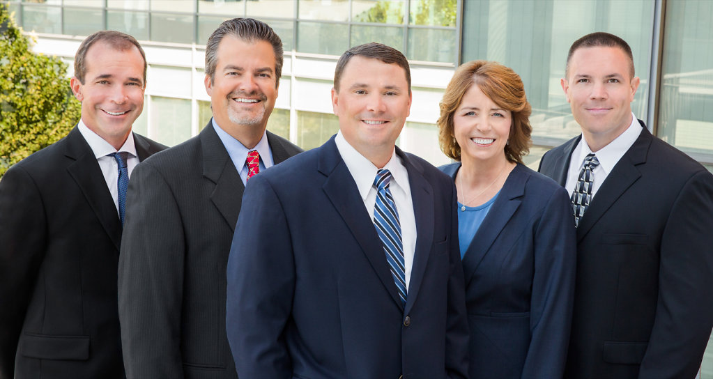 Construction executive group portrait in dark suits