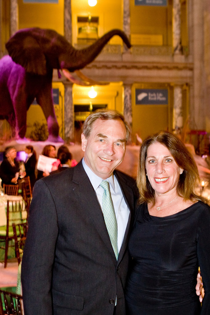 Business man and woman at Sacramento gala with elephant in background