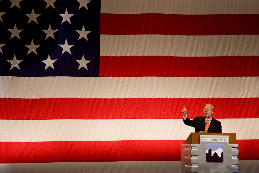 Public speaker  podium with American flag as backdrop