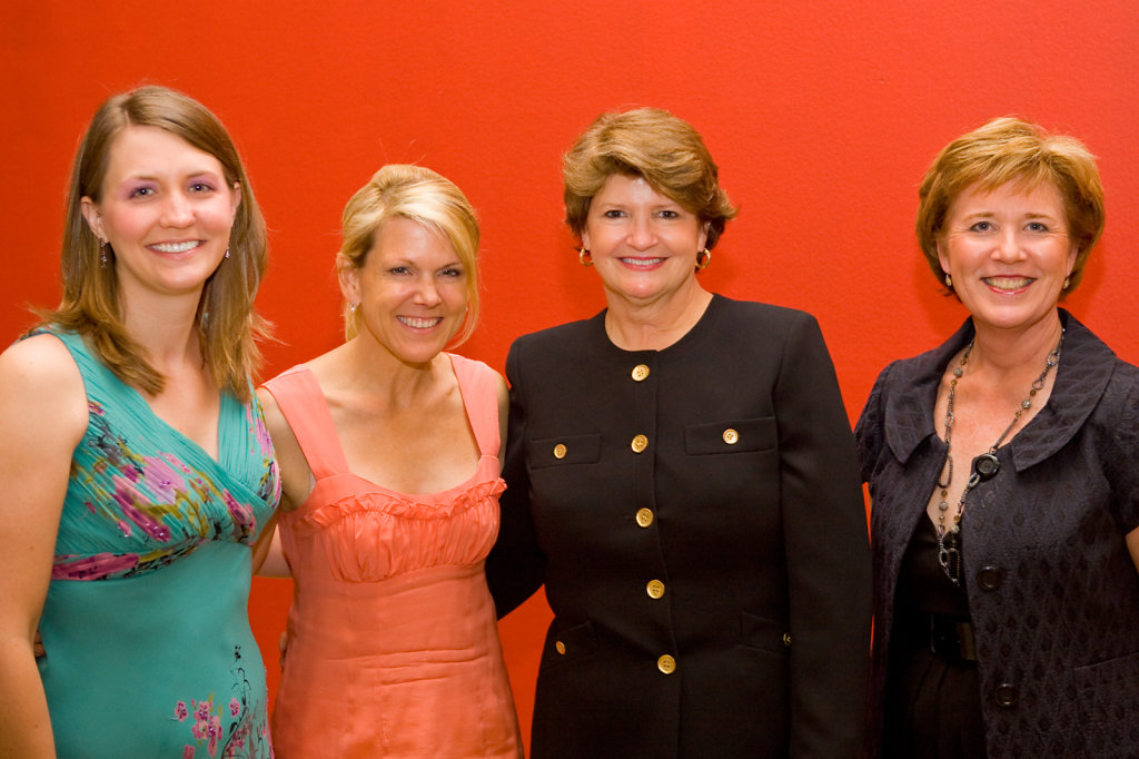 Business women at gala with orange background