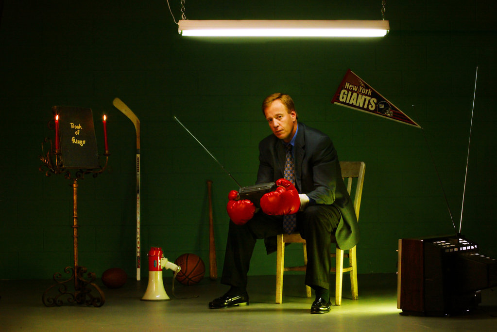 Grant Napier with boxing gloves listening to radio