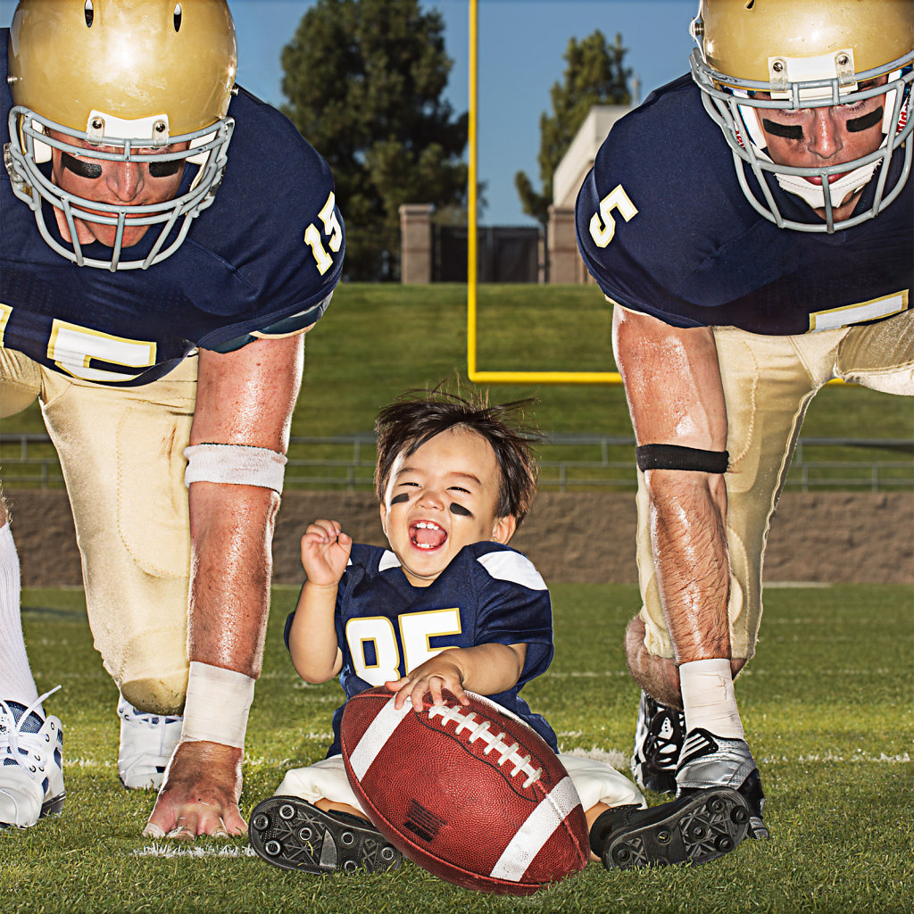 Little boy in pose with UC Davis football players