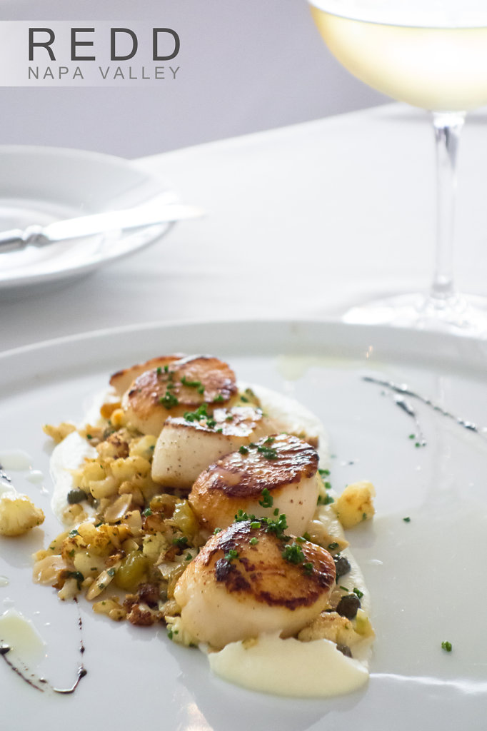 Seared scallops with pine nuts and creamy mashed potatoes in Napa Valley restaurant