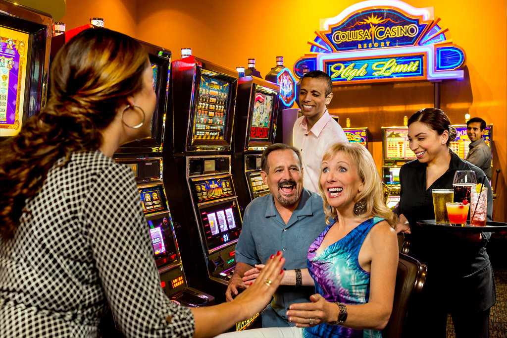 Excited woman at slots in casino