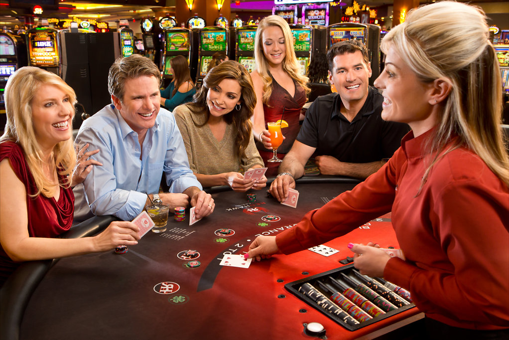 Players at blackjack table smiling