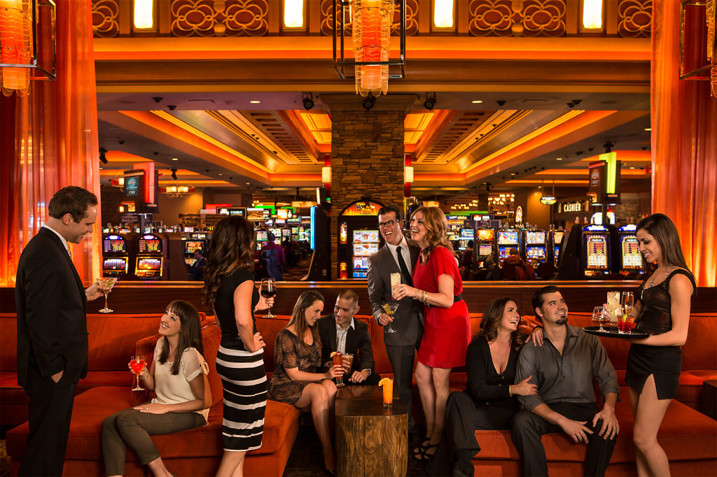 Young adults relaxing at casino lounge with drinks