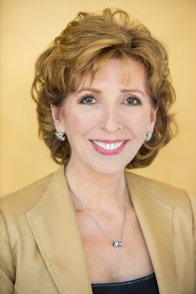 Professional Woman in Gold Suit Headshot