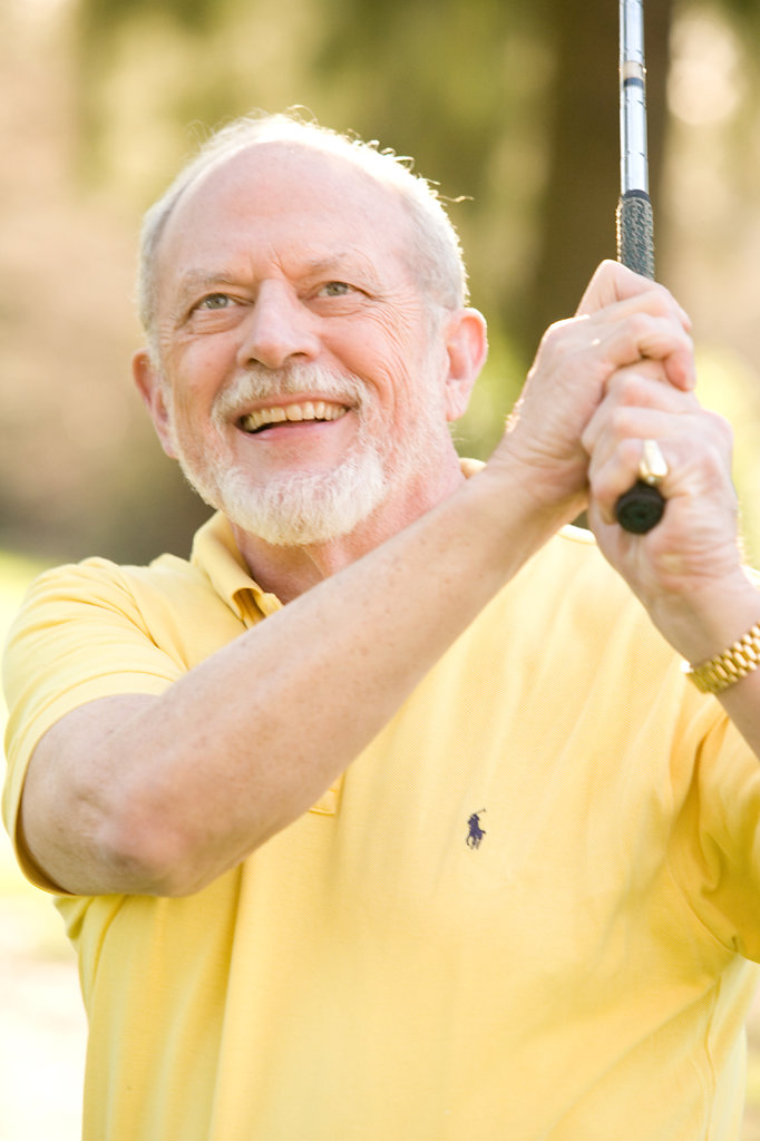Older man playing golf