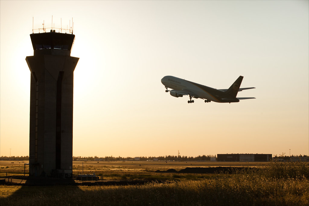 Sacramento Airport with control tower and jet takeoff