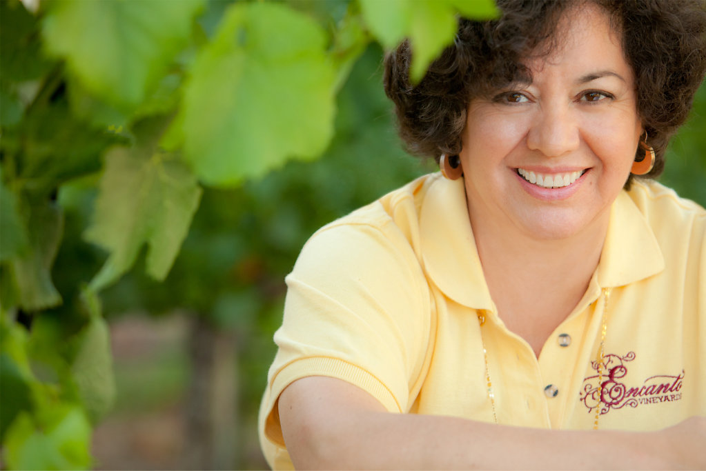 Woman vintner in vineyard