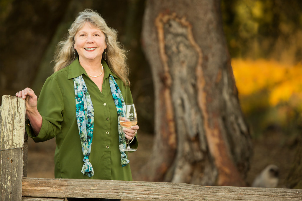 Lady with glass of wine at ranch