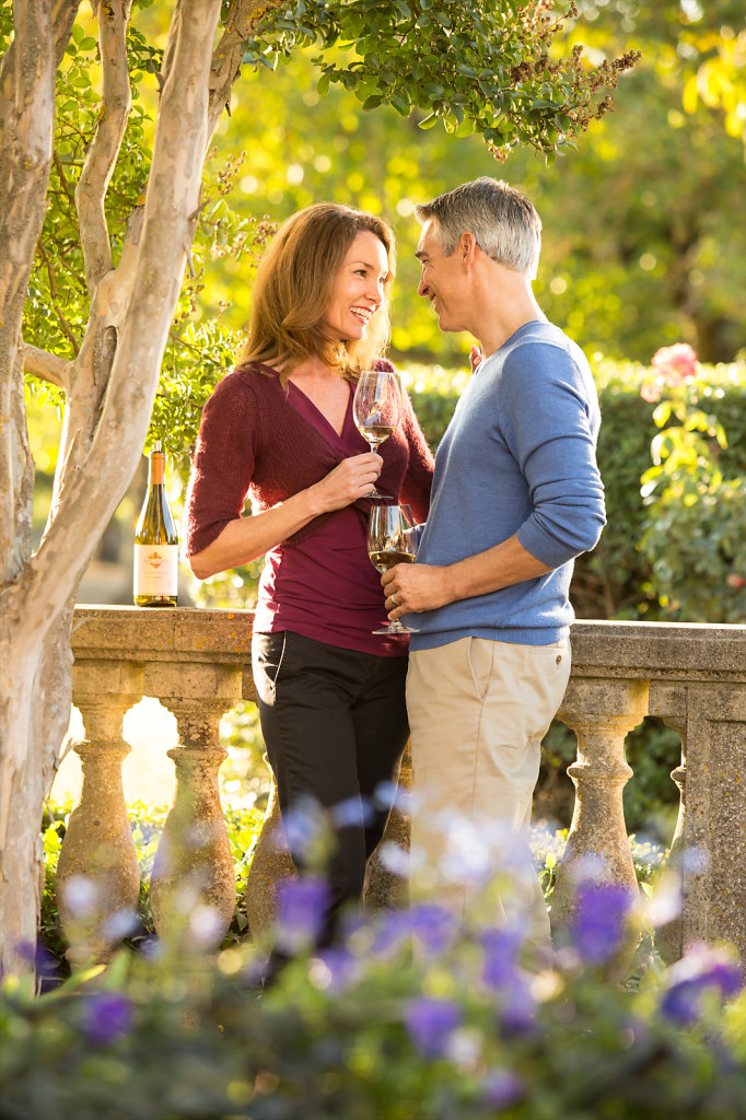Romantic couple sharing wine at Kendall Jackson winery
