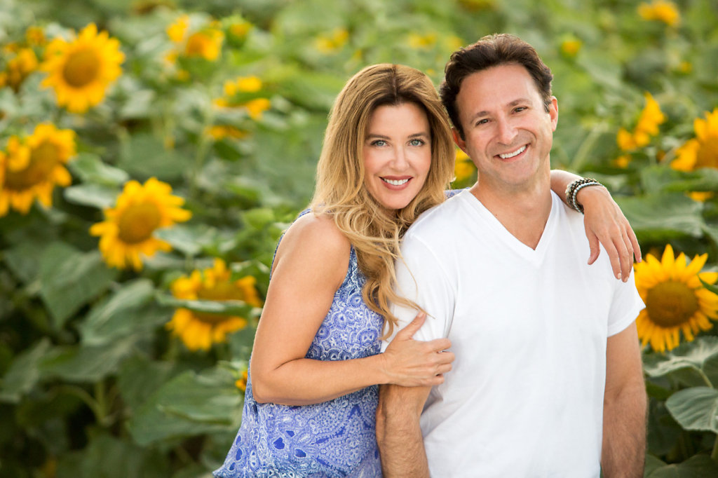 Couple smiling in sunflower field
