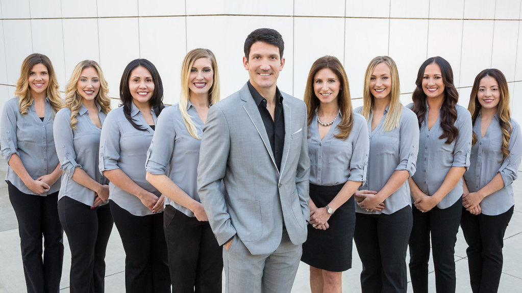 Sacramento dentist group portrait in grey suits and blouses