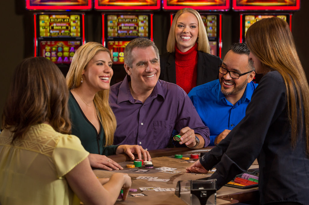 Mature couples at casino table with chips