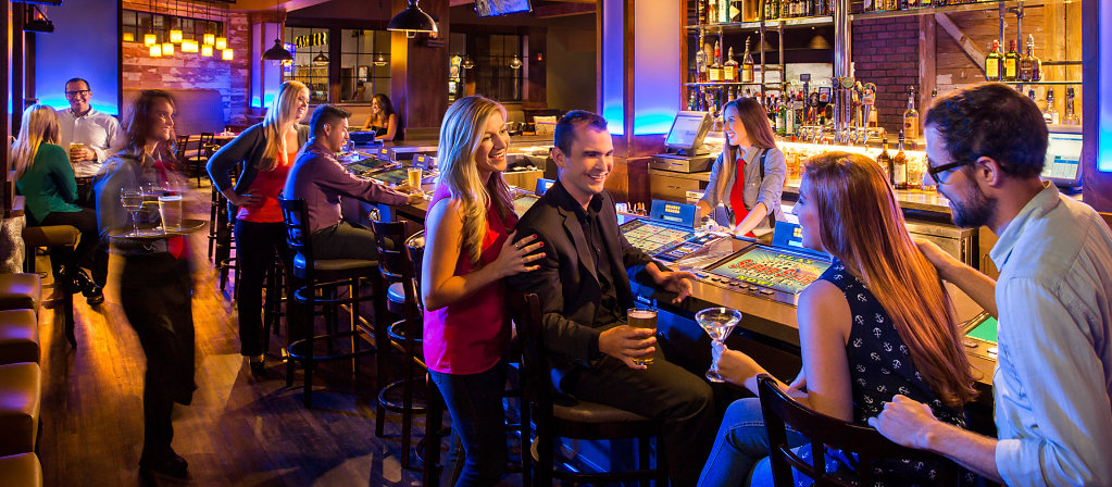 Couples relaxing at casino bar