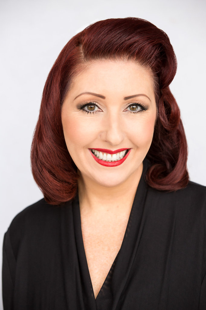 Professional Woman in Black Suit With Fifties Hairstyle Headshot