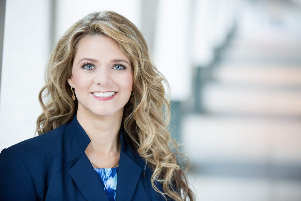 Professional Headshot of women with blonde hair in blue suit