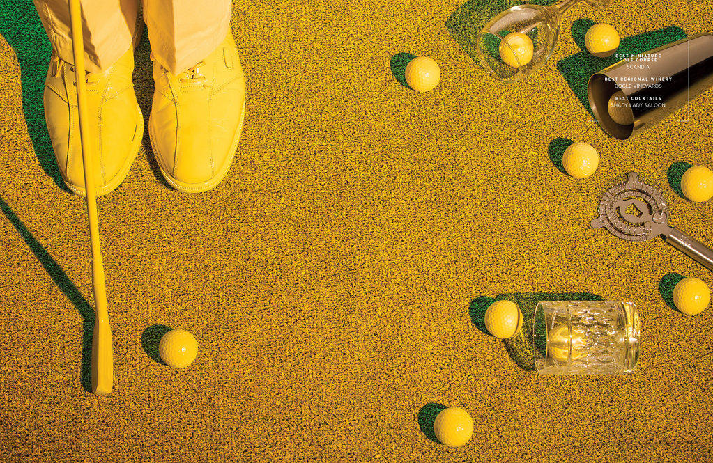 Yellow golf putter practicing