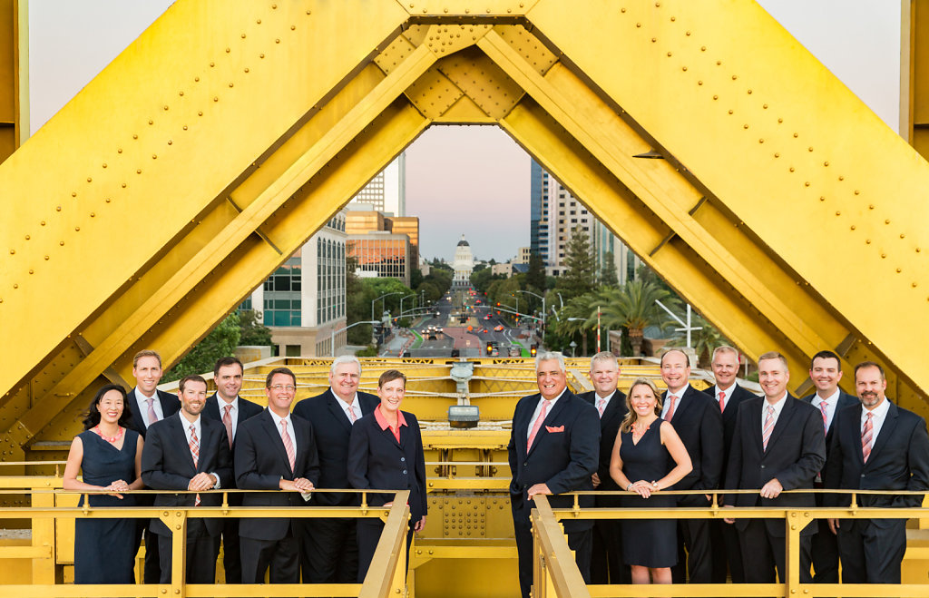Sacramento Law Firm group portrait on Tower Bridge with Capitol in background