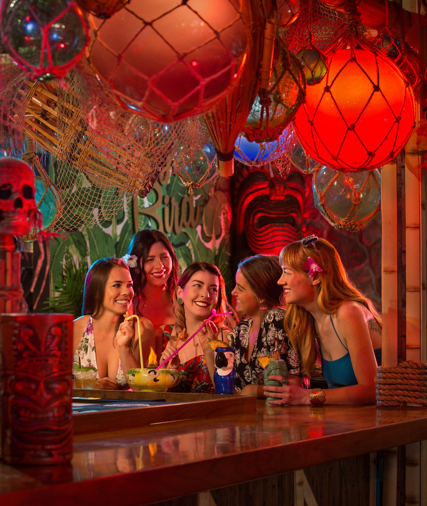 Young ladies at a tiki bar