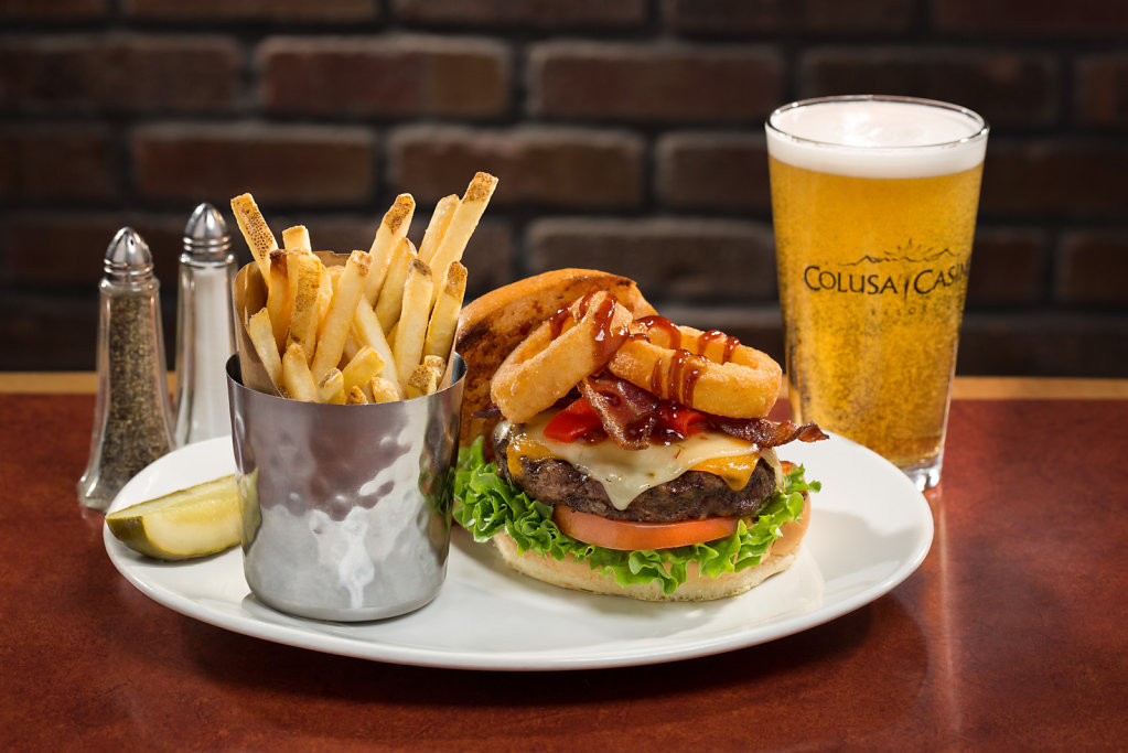 Bacon burger with onion rings and fries at Colusa Casino restaurant