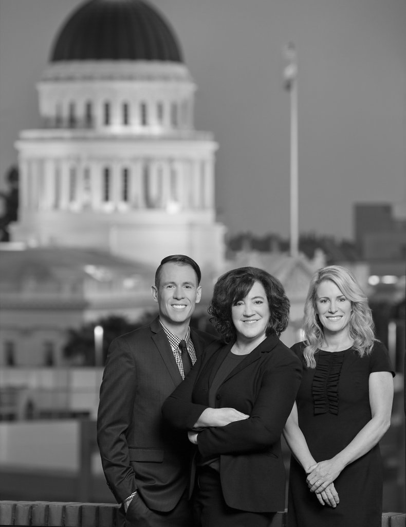Governmental relations executives group portrait in front of California State Capitol