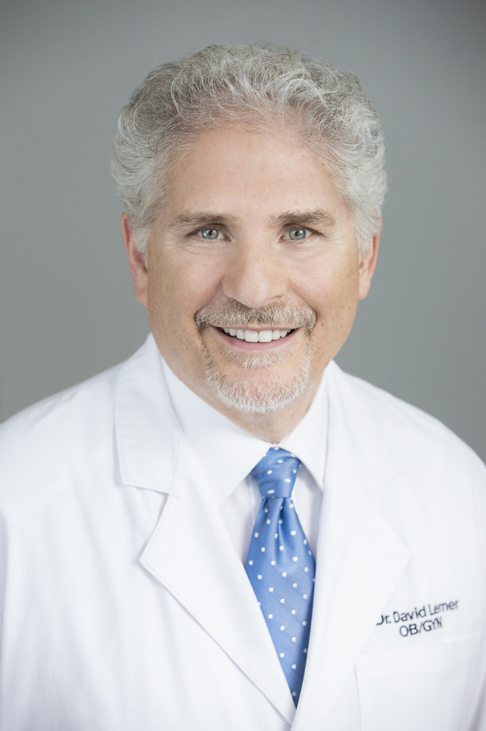 Male Doctor White Coat With Blue Tie