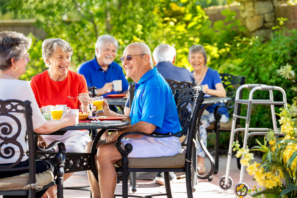 Retired people having breakfast in garden