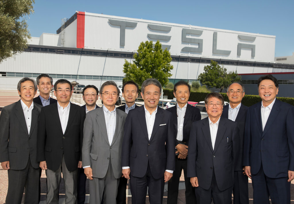 Business executives at the Tesla factory