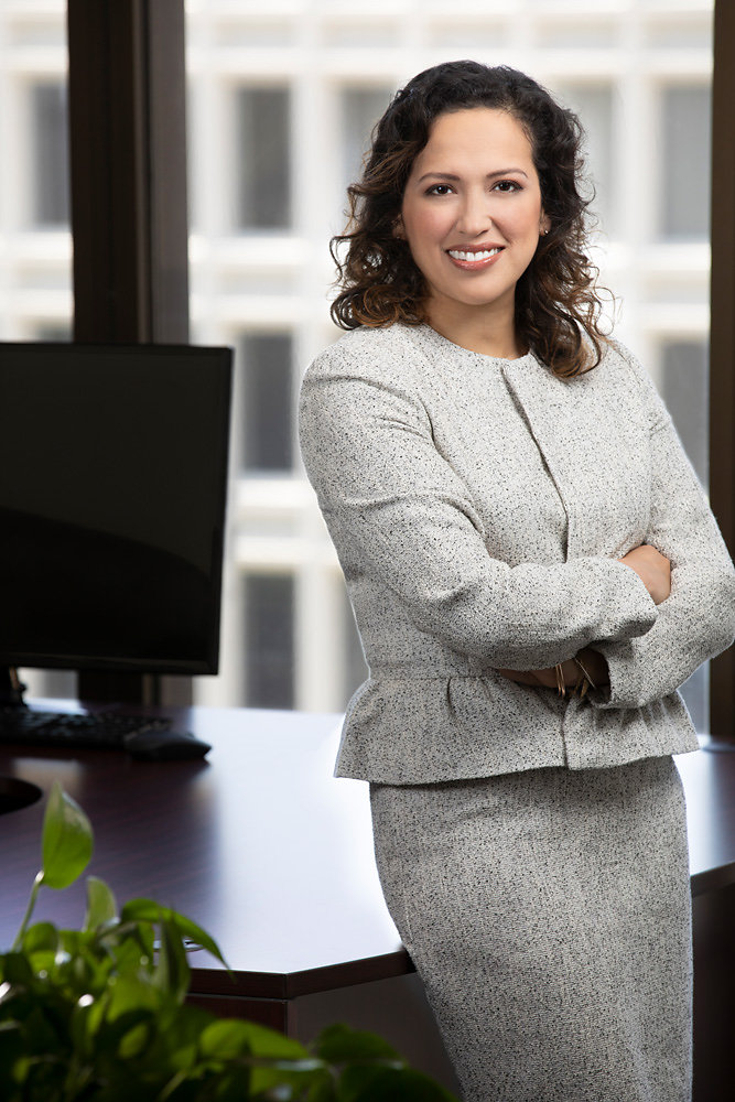 Business woman in grey suit standing